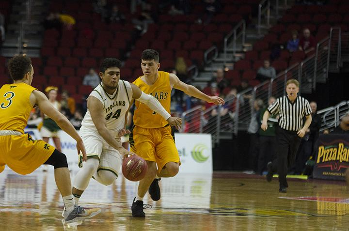 Izaya Ono-Fullard '17 drives down the court against the Kennedy Cougars in the 4a state semifinals at Wells Fargo Arena in Des Moines, Friday Mar. 10.