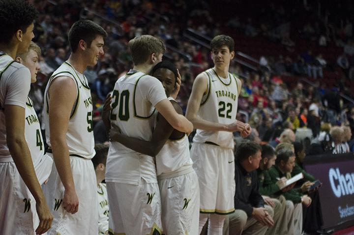 Nate Disterhoft '17 and Dante Eldridge '19 celebrate among teammates in the game against Cedar Rapids Kennedy at Wells Fargo Arena on Friday Mar. 10.