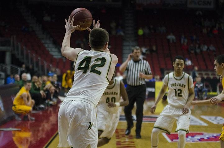 On the offensive, the Trojans pass the ball in the second half of the game against Kennedy in the 4a state semifinal at Wells Fargo Arena on Friday Mar. 10.