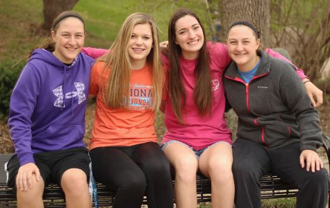 Allison Bys '17, Rylee Fay '20, Ellie Kouba '19 and Ashley Bys '17 smile together on a bench before school on Friday April 14th.