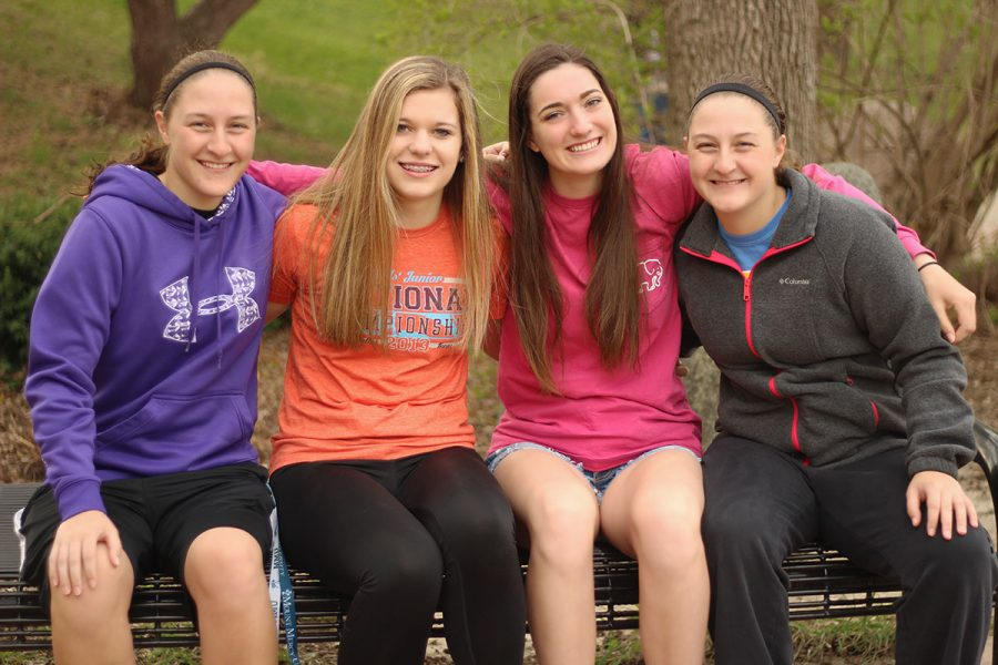 Allison+Bys+%2717%2C+Rylee+Fay+%2720%2C+Ellie+Kouba+%2719+and+Ashley+Bys+%2717+smile+together+on+a+bench+before+school+on+Friday+April+14th.+