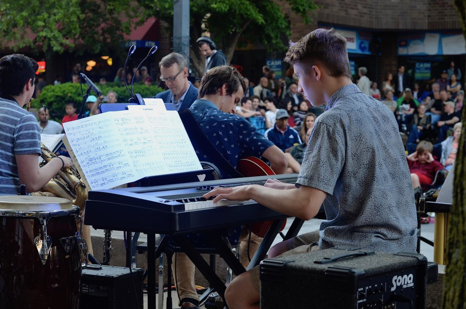 Andrew Burgess '20 concentrates on playing the keyboard as Rich Medd conducts the band through a piece.