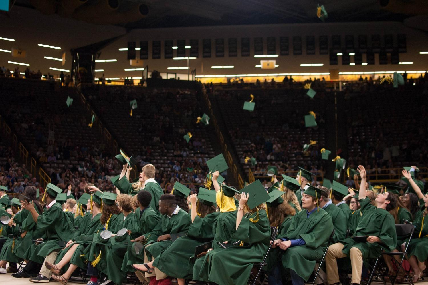 Finally graduates, students of the 2017 class of West High throw their caps into the air at Carver-Hawkeye Arena on May 27.