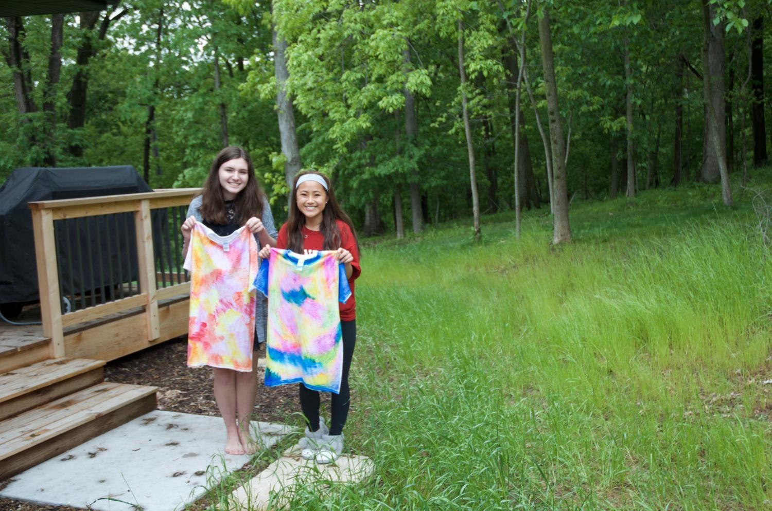 West side story staffers show off their tie-dye shirts.