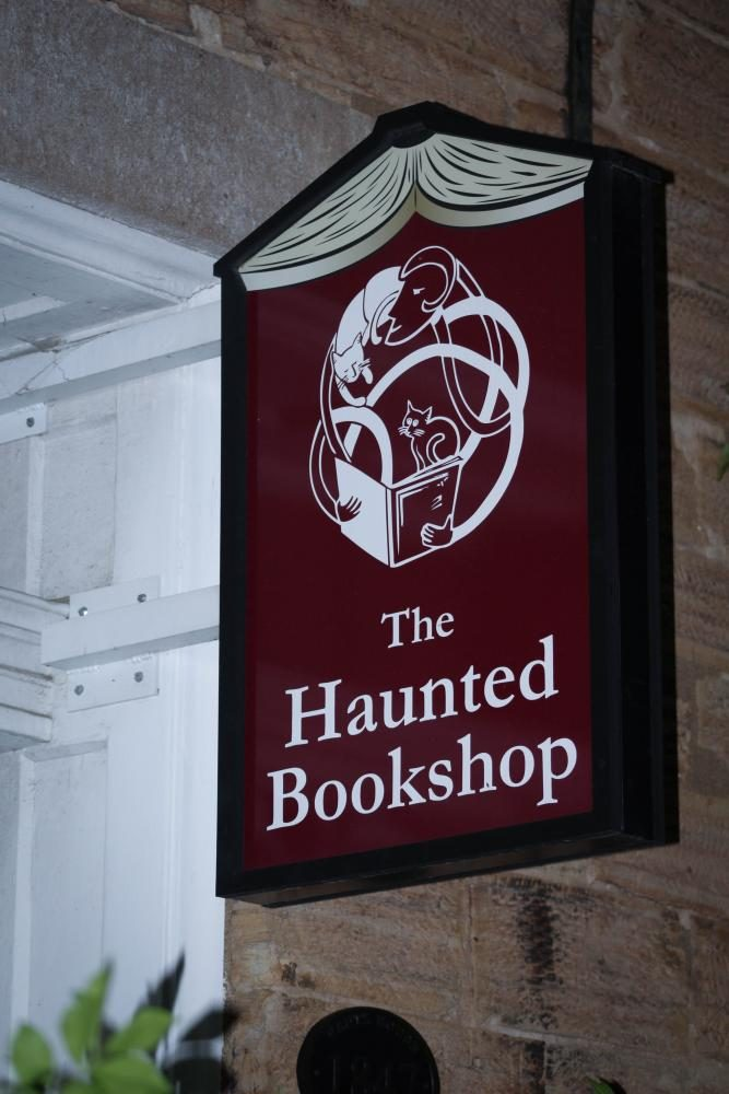 Sign of local book store, The Haunted Bookshop, located downtown Iowa City.