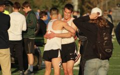 Jeff Garbutt '18 and Derek Nugent '17 hug each other after Garbutt attained a personal record during the 800 meter run, with a time of 2:00.29.
