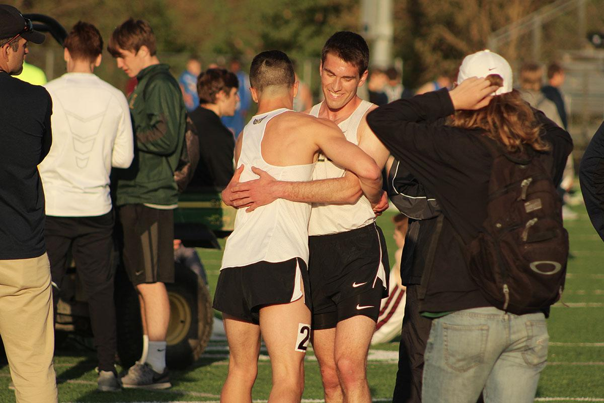 Jeff+Garbutt+%2718+and+Derek+Nugent+%2717+hug+each+other+after+Garbutt+attained+a+personal+record+during+the+800+meter+run%2C+with+a+time+of+2%3A00.29.