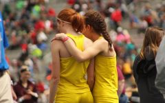 Deniz Ince '19 congratulates Claire Ronnebaum '17 after her leg in the girls 4x800 meter relay. The team placed 10th with a time of 9:45.76.