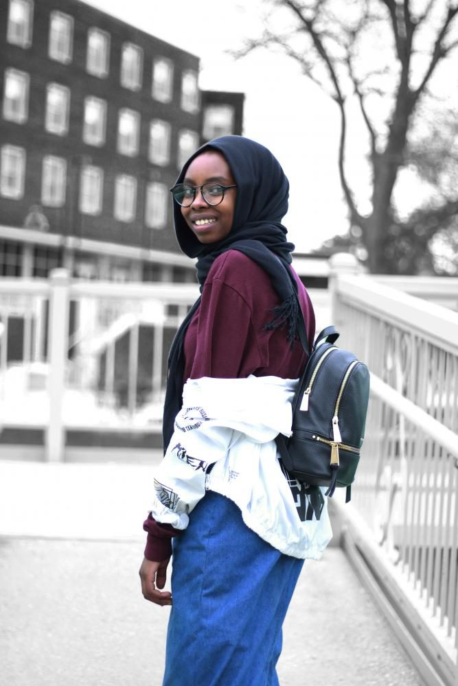 Ala Mohamed '17 models a simple spring outfit that she accessorized with her staple black leather backpack.