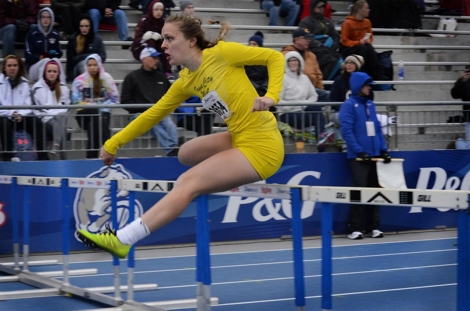 Peyton Steva '19 jumps over a hurdle during the girls shuttle hurdle relay on Saturday, May 29 at the Drake Relays. The girls placed second in the event.