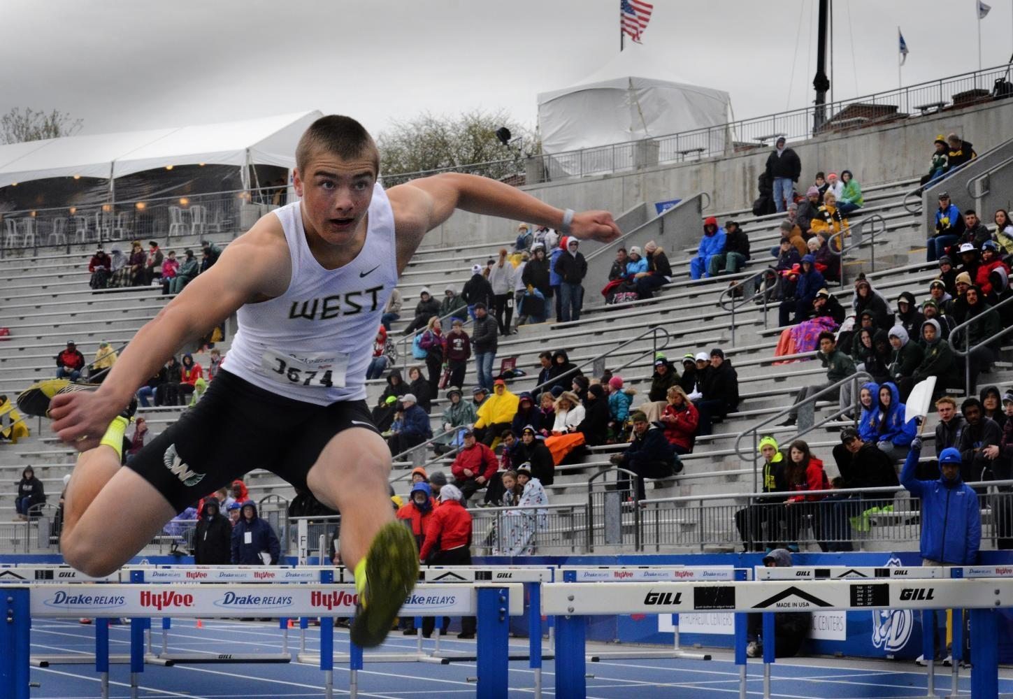 Cole Mabry '19 runs over a hurdle during boys shuttle hurdle relay on Saturday, May 29 at the Drake Relays. The West High boys placed ninth in the event.