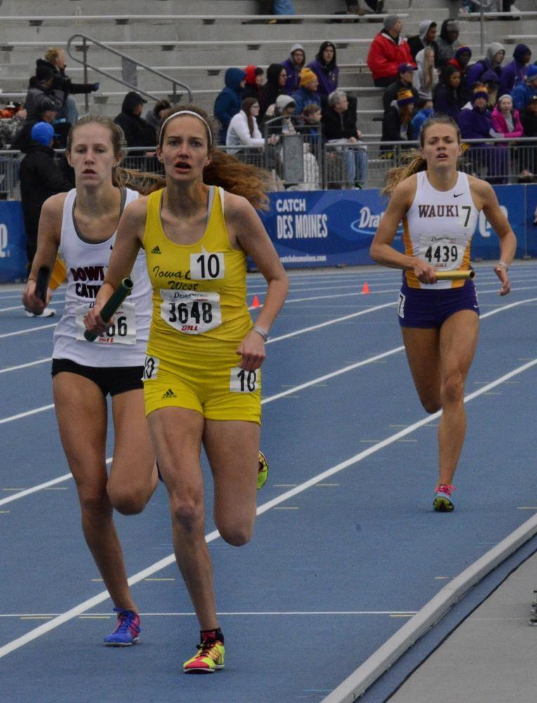 Bailey Nock '18 takes the lead in the girls 4x800-meter relay as she runs the anchor leg on Saturday, May 29 at the Drake Relays. Nock's leg was the fastest run in the entire girls high school 4 x 800-meter competition. The girls placed second in the event.