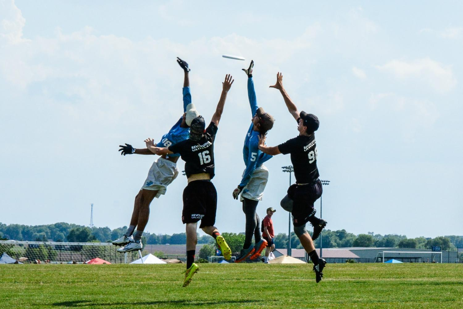 Ibo Pepic '17 and Dilon Crowell '17 jump for the disc.