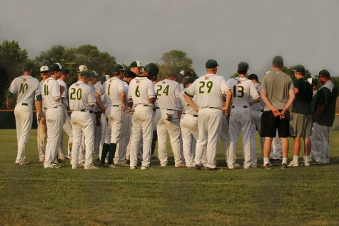 The team stands together in-between games.