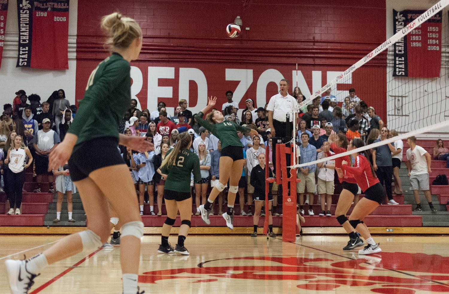 Emily+Burch+%2718+prepares+to+spike+the+ball+in+the+third+set+of+the+varsity+game+against+City+on+Sept.+5.