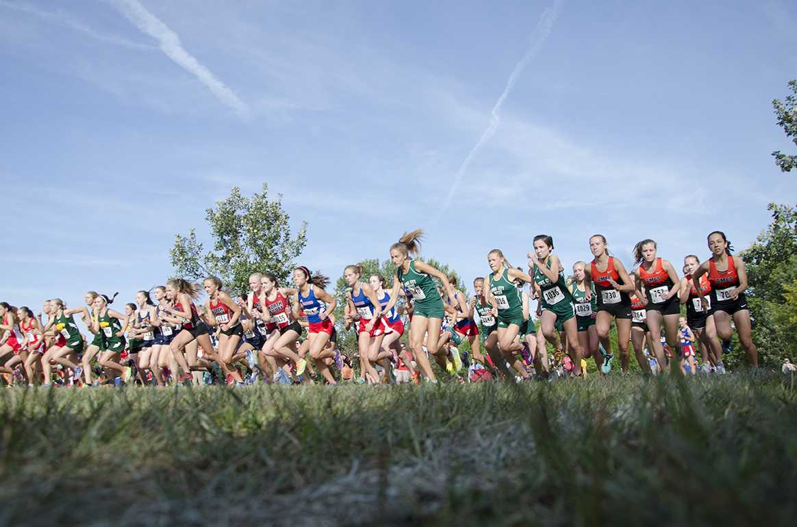 As+soon+as+the+starting+gun+fired+for+the+varsity+girls+cross+country+race%2C+runners+took+off+at+Noelridge+Park+on+Sept.+7.