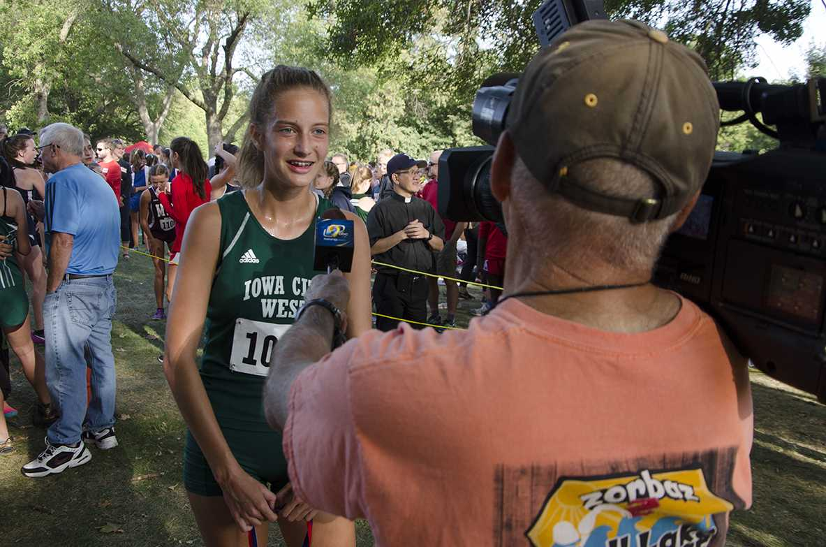 Post race, Bailey Nock '18 is interviewed by KCRG for placing first at the Cedar Rapids Invite at Noelridge Park on Sept. 7.