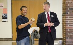 Superintendent Stephen Murley awards custodian Daniel Carlos with the Shine Award on Sept. 13 in the main commons.