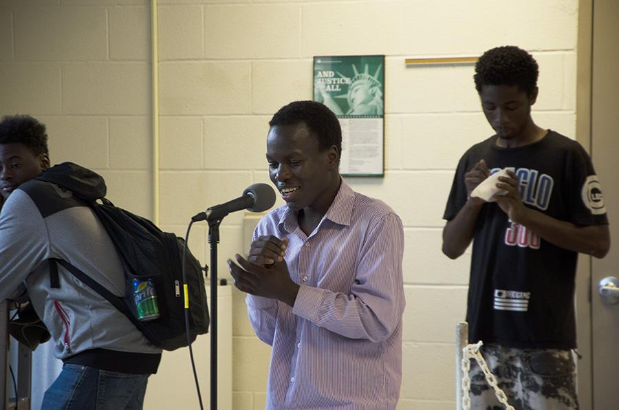 Byamangu Omari '20 smiles as he sings