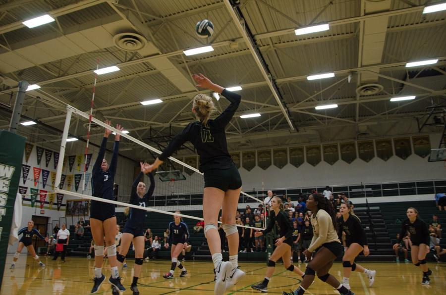 Scheel's Athlete of the Week, Maddie Laffey '18, gets ready to spike the ball in the first set of the game against Jefferson on Sept. 26.