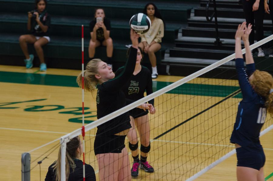 Colby Greene '18 spikes the ball in the second set of the game against Jefferson on Sept. 26.