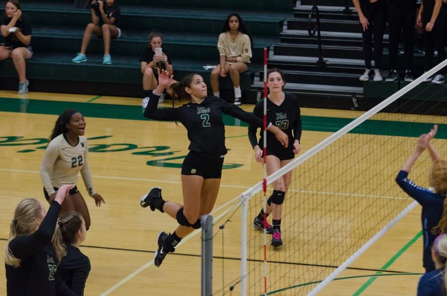 Cailyn Morgan '19 gets ready to spike in the second set of the varsity volleyball team against Jefferson on Sept. 26.