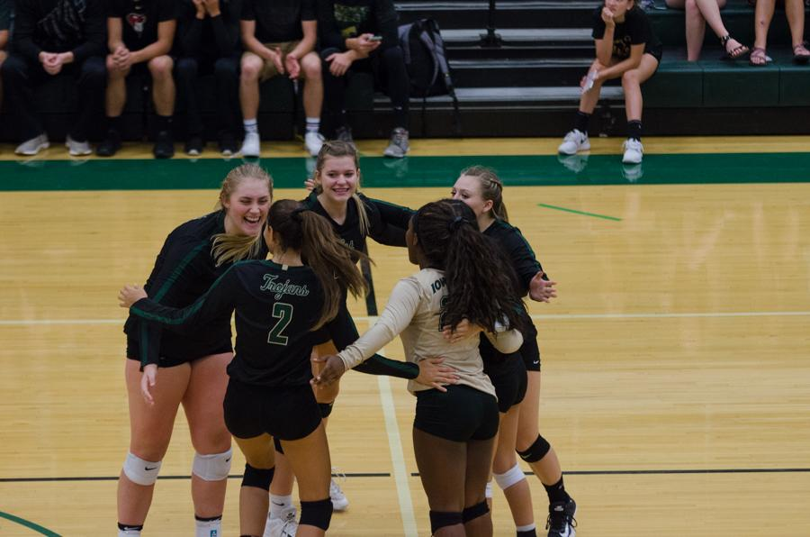 The varsity volleyball team huddles together after Cailyn Morgan '19 scores a point in the third set.