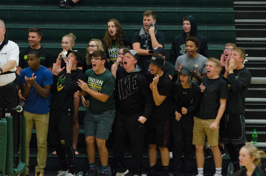 After the girls varsity volleyball team scores a point in the third set against Jefferson, the student section erupted with cheers on Sept. 26.