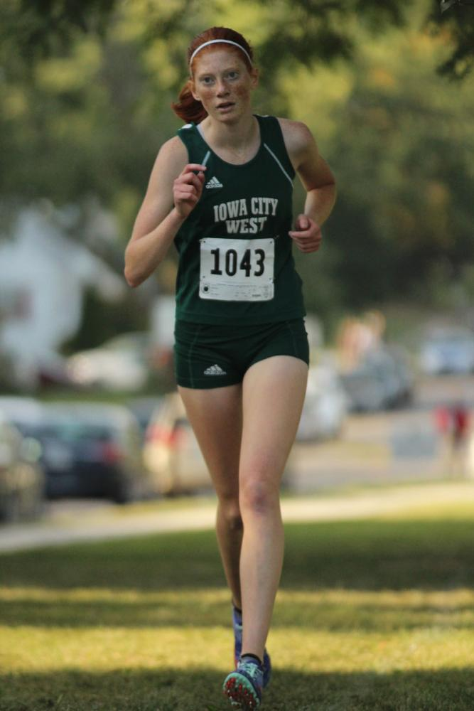 Claire+Ronnebaum+%2718+leads+the+pack+of+the+JV+race.+She+placed+5th+with+a+time+of+21%3A35+on+Thursday%2C+Sep.+7.+