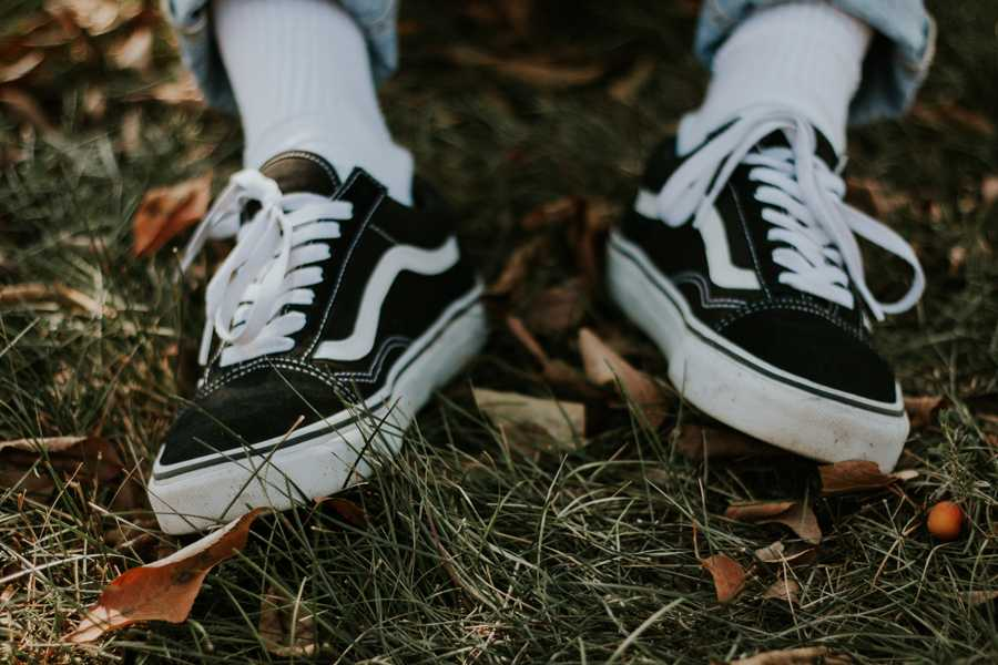 Vans are an essential for fall, here Elkins wears black Sk8-Hi's.