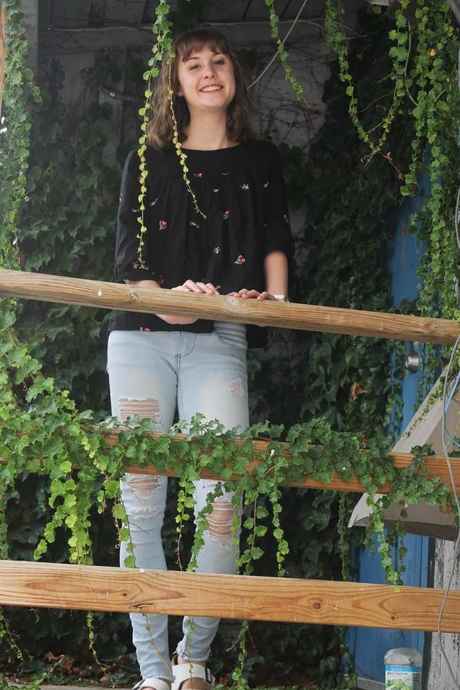 Marah+Fuller+%2719+wears+a+black+shirt+decorated+with+flowers%2C+ripped+jeans+she+got+from+Ross+and+white+Birkenstocks.