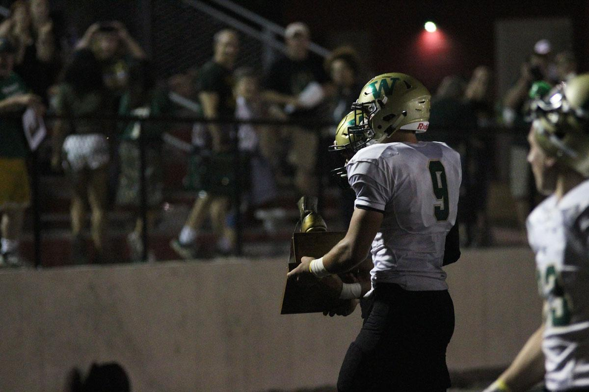 Dillon Doyle '18 carries The Boot to West's side on Friday, Sep. 15.