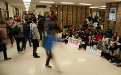 Alyson Kuennen is one of 10 finalists nationwide in NSPA's News Photo of the Year contest for this photo taken at a sit-in protest in the West High Commons in November 2016.
