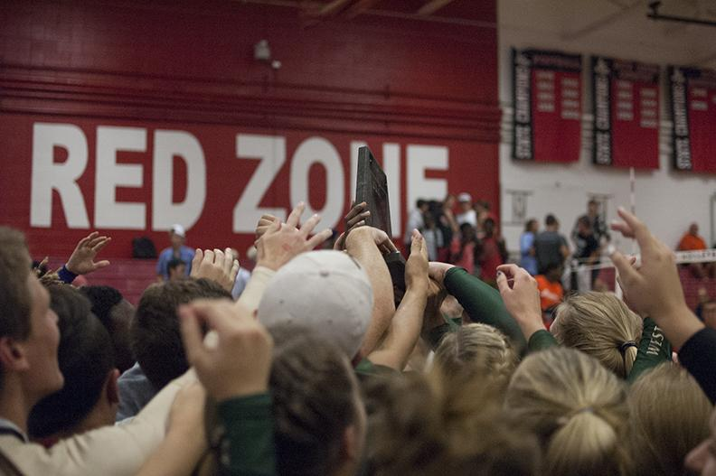 The Spike makes it's way through the triumphant hands of the girls varsity volleyball team and the student section that cheered them on after their win against City High on Sept. 5 for the third consecutive year.