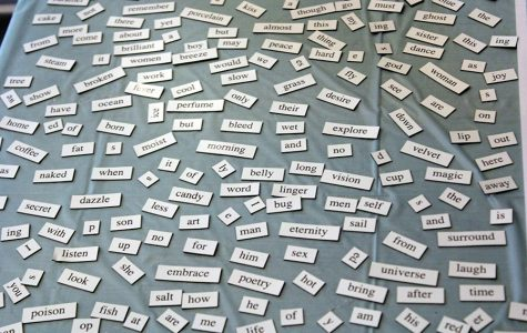 Single word magnets lay out on the table for the American Writers Museum waiting for someone to string them together into a poem.