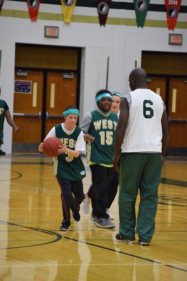 Jaden Buckley 19 grabs ahold of the basketball