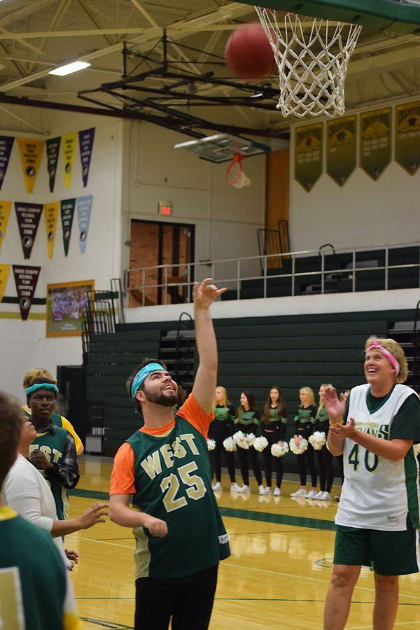 Orion Crowley 18 scores a basket during the faculty vs. Best Buddies and PALs basketball game on Oct. 25, 2017.