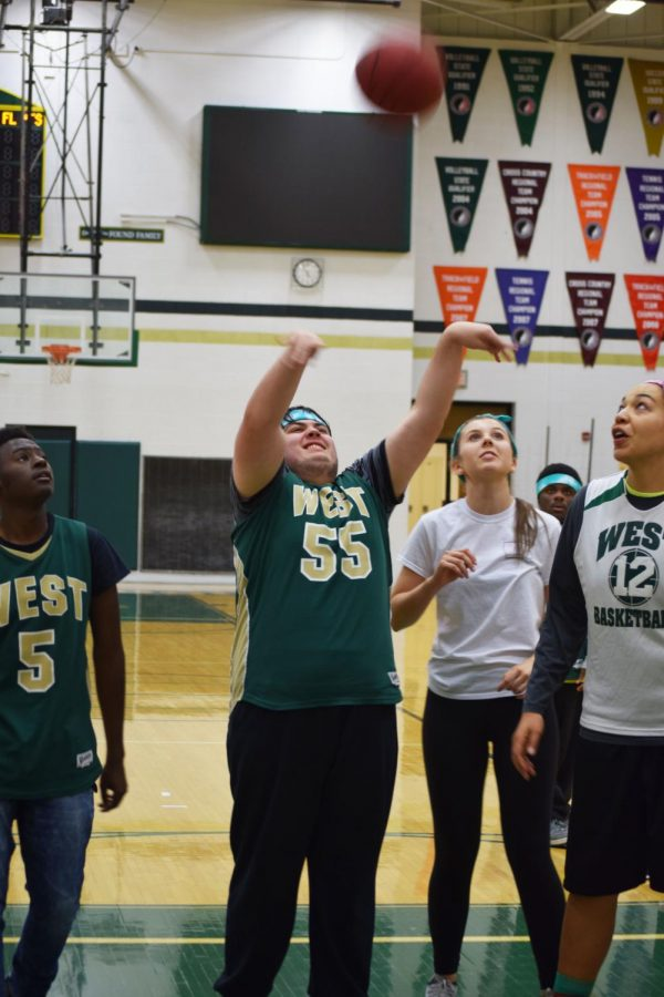 Chase Lonngren 20 scores a basket during the faculty vs. Best Buddies and PALs basketball game on Oct. 25, 2017.