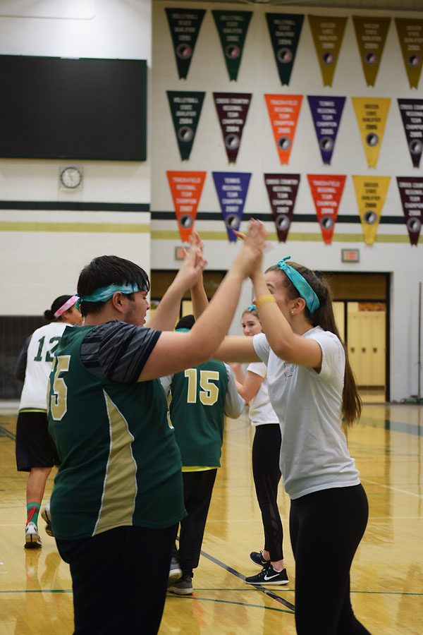 Chase Lonngren 20 and Hannah Luce 18 embrace each other after a Best Buddies and PALs win.