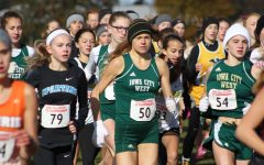 Colleen Bloeser '18 starts the race. She placed 58th with a time of 19:57 on Saturday, Oct. 28.