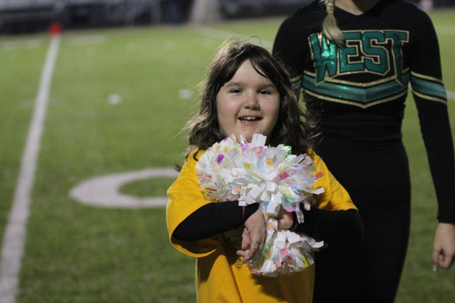 Kid+captain%2C+Lucy+Roth+smiles+as+she+walks+off+the+field+on+Friday%2C+Oct.+6.