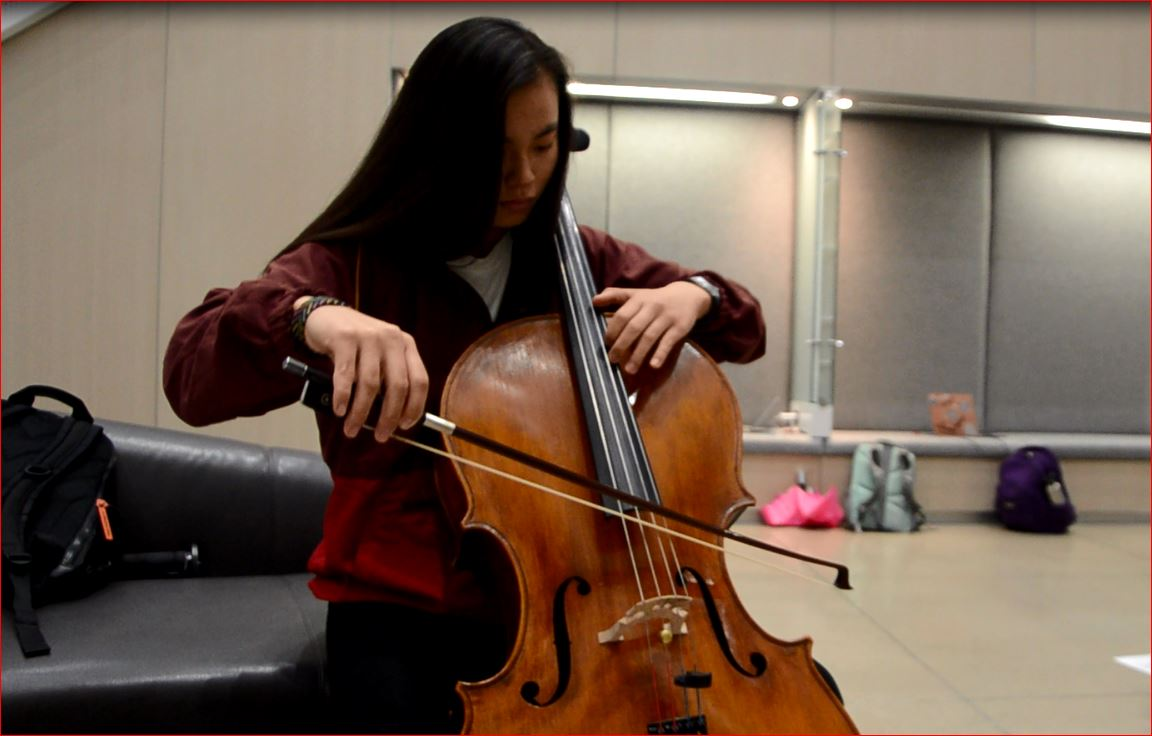 Along with band members, orchestra and choir students will audition for spots into All-State on Oct. 21. Above, Meleah Chang '18 practices for a mock audition at the All-State Strings Workshop on Oct. 14 at the Voxman Music Building.