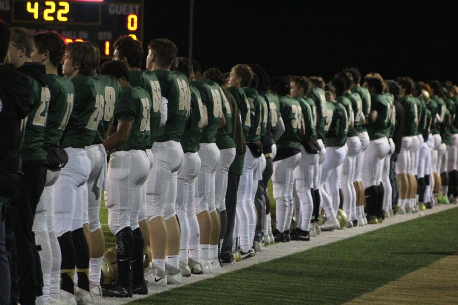 The team stands together during the national anthem on Friday, Nov. 3.