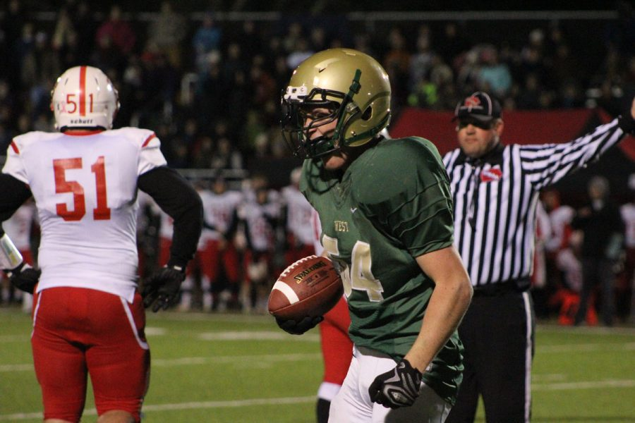 Caden+Fedeler+%2718+celebrates+after+he+recovered+a+fumble+for+the+Trojans+on+Friday%2C+Nov.+3.