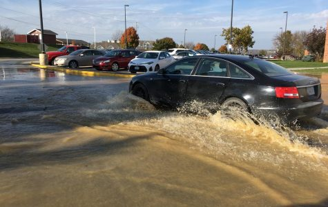 Back parking lot floods, water at West turned off