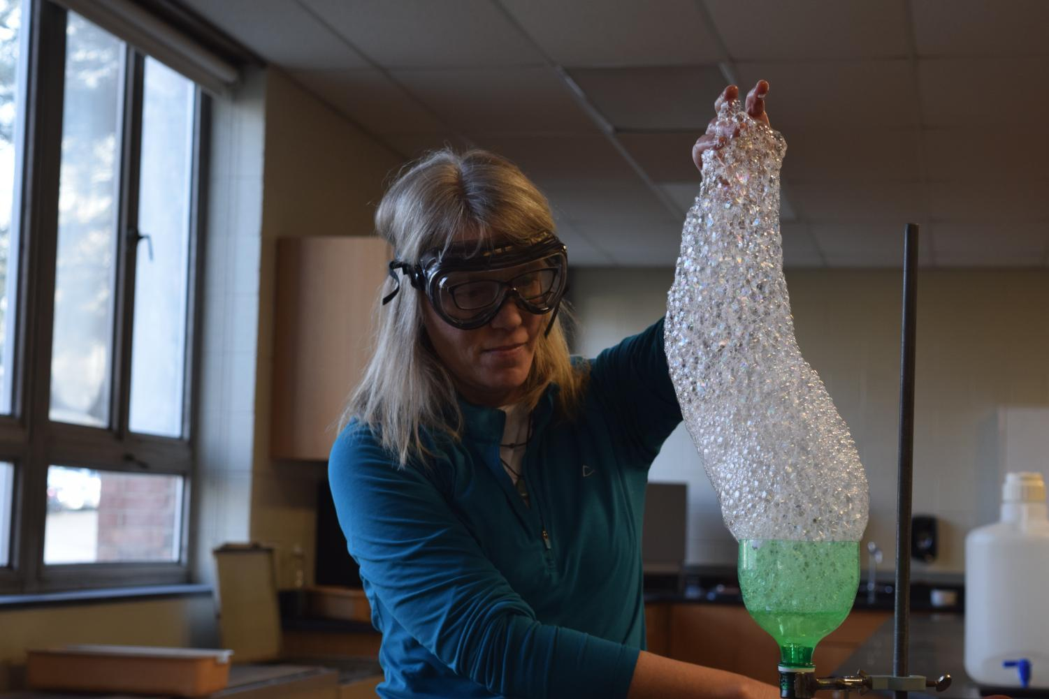 Wikner pulls bubbles during one of her many lab demos for students.