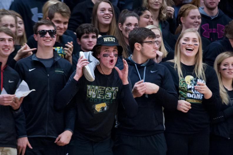 West student section members try to distract City's free throw shooters during the varsity girl's basketball game against on Dec. 12.