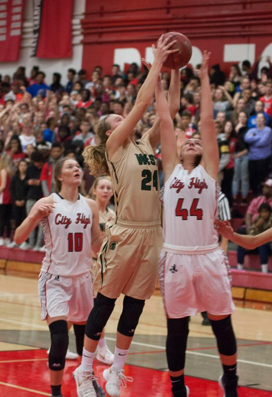 Emma Koch '19 reaches for a rebound in the game against City on Dec. 12.