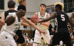 Patrick McCaffery '19 holds the ball away from Dowling's Sam Ingoli '18 on Thursday, Nov. 30.