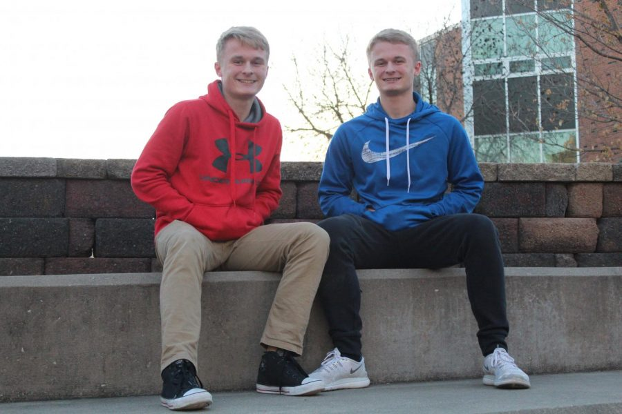 Noah and Jonah Terwilleger 19 pose in the back courtyard of West High